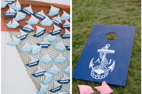 Origami Sailboat escort cards and nautical corn hole boards at a wedding: : planned by Lauryn Prattes with Table 6 Productions; photography by Abby Jiu Photography, flowers by Holly Chapple Flowers