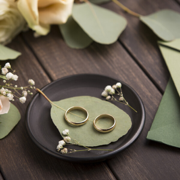 creative golden wedding rings on small black plate | four wedding trends in 2021